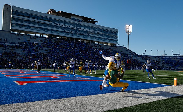 Kansas cornerback Hasan Defense (13) breaks up an end zone pass to Baylor Bears wide receiver Denzel Mims (5) during the second quarter on Saturday, Nov. 30, 2019 at Memorial Stadium.