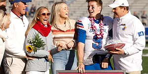 Kansas quarterback Carter Stanley (9) and Kansas head coach Les Miles laugh with Stanley's family during the pregame senior recognition ceremony on Saturday, Nov. 30, 2019 at Memorial Stadium.