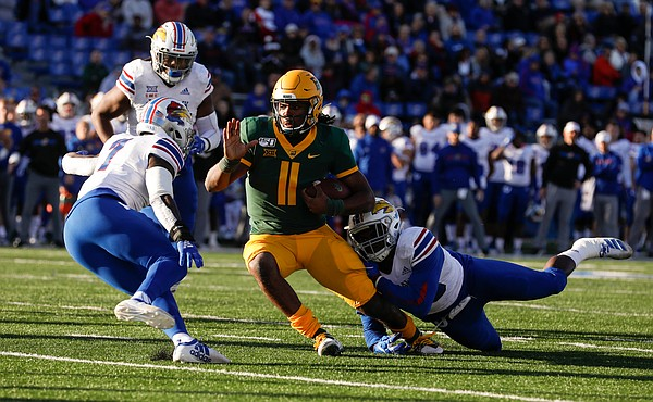 Kansas linebacker Kyron Johnson (15), right, and Kansas safety Davon Ferguson (7) try to corral Baylor Bears quarterback Gerry Bohanon (11) during the second quarter on Saturday, Nov. 30, 2019 at Memorial Stadium.
