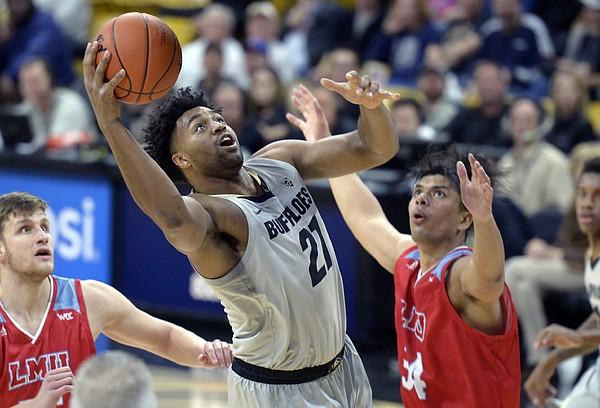 Colorado center Evan Battey shoots next to Loyola Marymount forward Keli Leaupepe, right, during the second half of an NCAA college basketball game Wednesday, Dec. 4, 2019, in Boulder, Colo. (AP Photo/Cliff Grassmick)