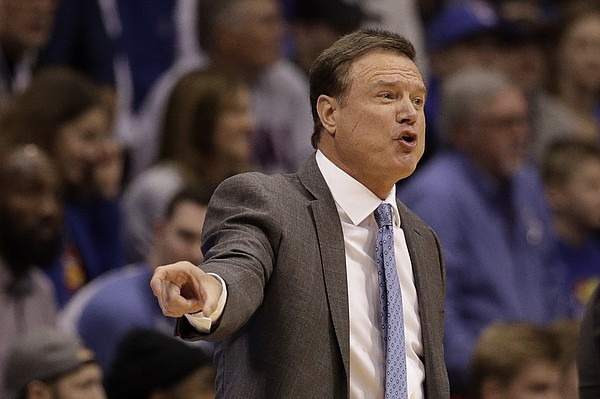 Kansas head coach Bill Self talks to his players during the first half of an NCAA college basketball game against Colorado, Saturday, Dec. 7, 2019, in Lawrence, Kan. (AP Photo/Charlie Riedel)