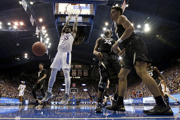 Kansas' Udoka Azubuike dunks during the first half of an NCAA college basketball game against Colorado, Saturday, Dec. 7, 2019, in Lawrence, Kan. Kansas won 72-58. (AP Photo/Charlie Riedel)
