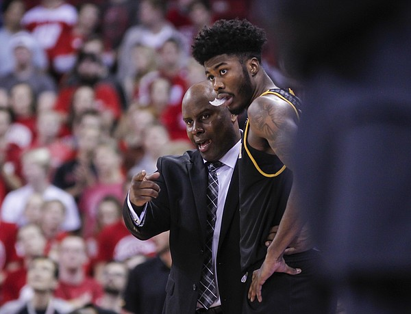 Milwaukee head coach Pat Baldwin and Vance Johnson during the second half of an NCAA college basketball game Friday, Nov. 24, 2017, in Madison, Wis. Wisconsin won 71-49. (AP Photo/Andy Manis)