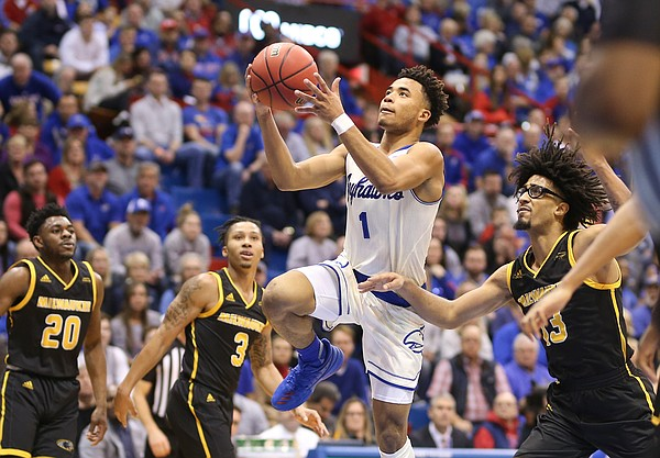 Kansas guard Devon Dotson (1) elevates for a bucket past Milwaukee guard Courtney Brown Jr. (13) during the first half, Tuesday, Dec. 10, 2019 at Allen Fieldhouse.