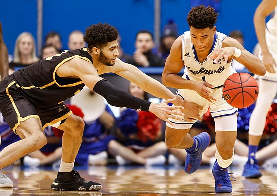 Kansas guard Devon Dotson (1) comes away with a steal from Milwaukee center Amir Allen (12) during the second half, Tuesday, Dec. 10, 2019 at Allen Fieldhouse.