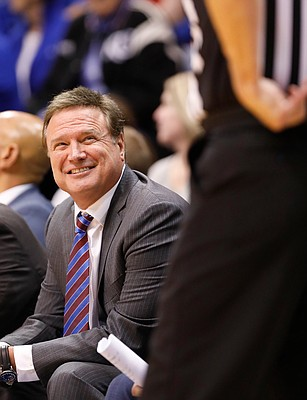 Kansas head coach Bill Self has a laugh with a game official during the second half, Tuesday, Dec. 10, 2019 at Allen Fieldhouse.