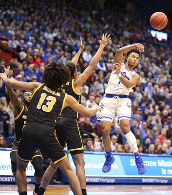 Kansas guard Devon Dotson (1) throws a pass to the wing during the first half, Tuesday, Dec. 10, 2019 at Allen Fieldhouse.