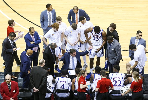 Kansas head coach Bill Self huddles up with his players during a timeout in the first half, Saturday, Dec. 14, 2019 at Sprint Center in Kansas City, Mo.