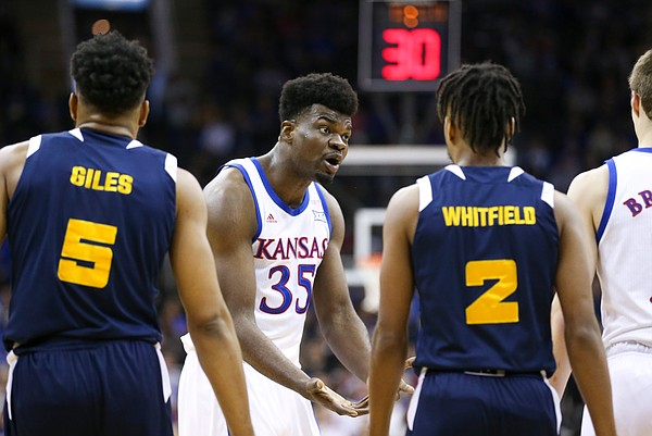 Kansas center Udoka Azubuike (35) gets the attention of Kansas guard Christian Braun (2) during the first half, Saturday, Dec. 14, 2019 at Sprint Center in Kansas City, Mo.