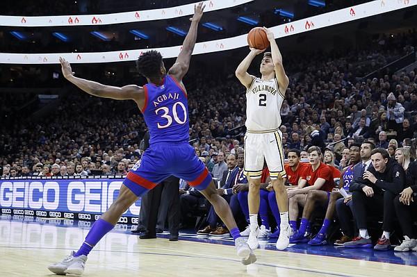 Villanova's Collin Gillespie (2) shotos over Kansas' Ochai Agbaji (30) during the first half of an NCAA college basketball game, Saturday, Dec. 21, 2019, in Philadelphia. (AP Photo/Matt Slocum)