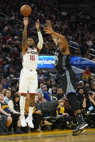 Houston Rockets guard Ben McLemore (16) takes a 3-point shot next to Golden State Warriors forward Glenn Robinson III (22) during the first half of an NBA basketball game in San Francisco, Wednesday, Dec. 25, 2019. (AP Photo/Tony Avelar)