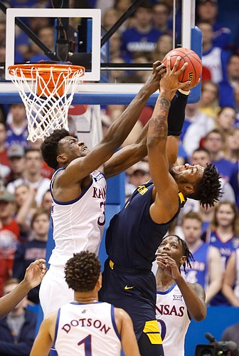 Kansas center Udoka Azubuike (35) and West Virginia forward Derek Culver (1) fight for a rebound during the second half, Saturday, Jan. 4, 2020 at Allen Fieldhouse.