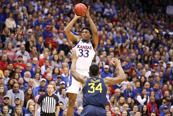 Kansas forward David McCormack (33) pulls up for a shot over West Virginia forward Oscar Tshiebwe (34) during the first half, Saturday, Jan. 4, 2020 at Allen Fieldhouse.