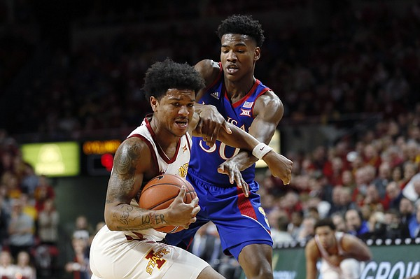 Iowa State guard Prentiss Nixon steals the ball from Kansas guard Ochai Agbaji, right, during the first half of an NCAA college basketball game Wednesday, Jan. 8, 2020, in Ames, Iowa. (AP Photo/Charlie Neibergall)