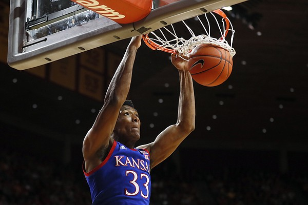 Kansas forward David McCormack dunks during the first half of the team's NCAA college basketball game against Iowa State, Wednesday, Jan. 8, 2020, in Ames, Iowa. (AP Photo/Charlie Neibergall)