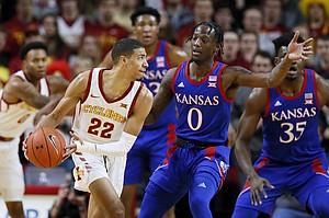 Iowa State guard Tyrese Haliburton (22) looks to pass the ball around Kansas guard Marcus Garrett (0) during the first half of an NCAA college basketball game Wednesday, Jan. 8, 2020, in Ames, Iowa. (AP Photo/Charlie Neibergall)