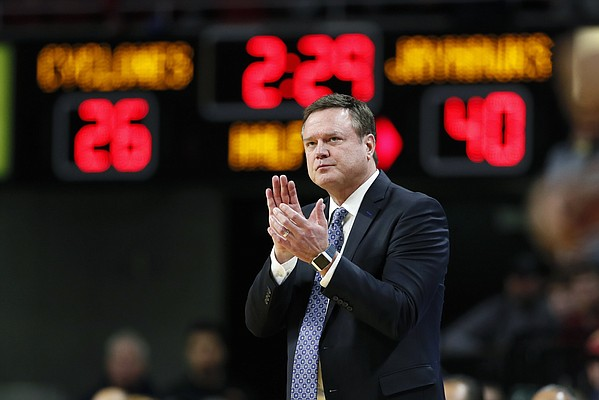 Kansas coach Bill Self applauds his team during the first half of an NCAA college basketball game against Iowa State, Wednesday, Jan. 8, 2020, in Ames, Iowa. (AP Photo/Charlie Neibergall)