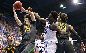 Baylor Bears guard Matthew Mayer (24) comes away with a rebound from Kansas Jayhawks center Udoka Azubuike (35) during the second half on Saturday, Jan. 11, 2020 at Allen Fieldhouse.