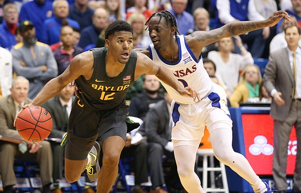 Baylor guard Jared Butler (12) gets around Kansas guard Marcus Garrett (0) as he heads to the bucket during the second half on Saturday, Jan. 11, 2020 at Allen Fieldhouse.