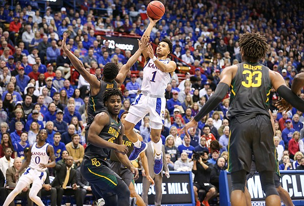 Kansas Jayhawks guard Devon Dotson (1) puts a floater over Baylor Bears guard Jared Butler (12) during the first half on Saturday, Jan. 11, 2020 at Allen Fieldhouse.