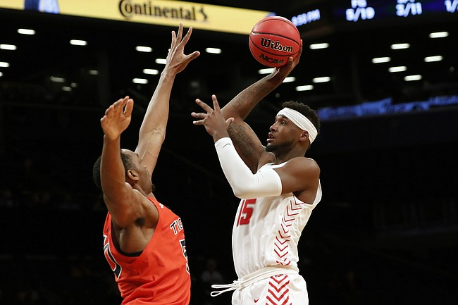 New Mexico forward Carlton Bragg Jr. (15) shoots with Auburn center Austin Wiley (50) defending during the first half of an NCAA college basketball game in the Legends Classic, Monday, Nov. 25, 2019, in New York. (AP Photo/Kathy Willens)