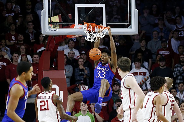 Kansas' David McCormack (33) dunks during the second half of the team's NCAA college basketball game against Oklahoma in Norman, Okla., Tuesday, Jan. 14, 2020. (AP Photo/Garett Fisbeck)