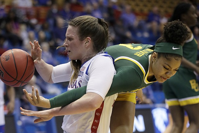 Kansas center Bailey Helgren, left, and Baylor guard Trinity Oliver (3) vie for a loose ball during the first half of an NCAA college basketball game in Lawrence, Kan., Wednesday, Jan. 15, 2020. (AP Photo/Orlin Wagner)