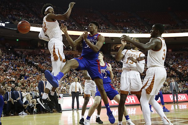 Kansas forward David McCormack (33) loses control of the ball as he tries to score past Texas forward Kai Jones (22) during the first half of an NCAA college basketball game, Saturday, Jan. 18, 2020, in Austin, Texas. (AP Photo/Eric Gay)