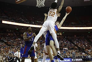 Texas forward Kai Jones (22) blocks Kansas guard Christian Braun, right, from scoring during the first half of an NCAA college basketball game, Saturday, Jan. 18, 2020, in Austin, Texas. (AP Photo/Eric Gay)