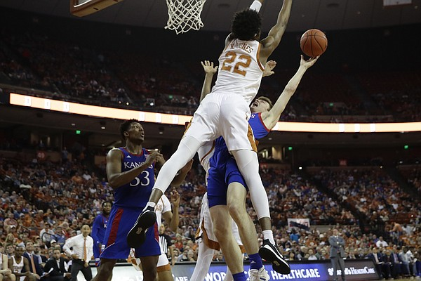 Texas forward Kai Jones (22) blocks Kansas guard Christian Braun, right, from scoring during the first half of an NCAA college basketball game, Saturday, Jan. 18, 2020, in Austin, Texas. (AP Photo/Eric Gay)
