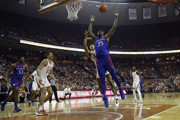 Kansas center Udoka Azubuike (35) is fouled by Texas forward Jericho Sims (20) during the first half of an NCAA college basketball game, Saturday, Jan. 18, 2020, in Austin, Texas. (AP Photo/Eric Gay)