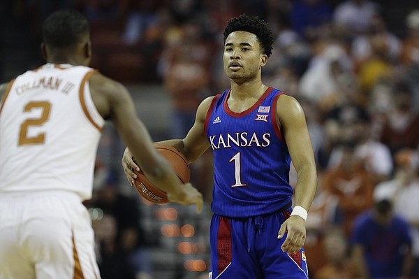 Kansas guard Devon Dotson (1) brings the ball up court against Texas guard Matt Coleman III (2) during the first half of an NCAA college basketball game, Saturday, Jan. 18, 2020, in Austin, Texas. (AP Photo/Eric Gay)