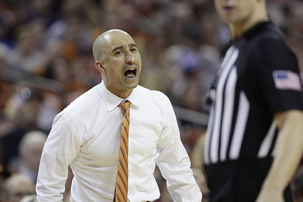 Texas head coach Shaka Smart argues a call during the first half of an NCAA college basketball game against Kansas, Saturday, Jan. 18, 2020, in Austin, Texas. (AP Photo/Eric Gay)