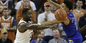 Texas guard Courtney Ramey (3) is pressured by Kansas guard Devon Dotson (1) during the first half of an NCAA college basketball game, Saturday, Jan. 18, 2020, in Austin, Texas. (AP Photo/Eric Gay)