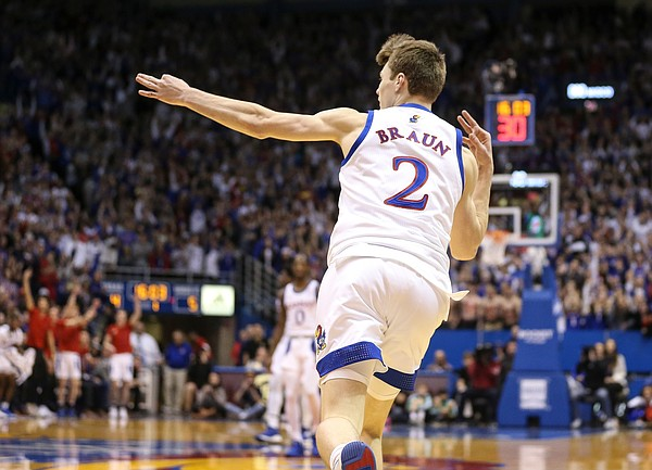 Kansas guard Christian Braun (2) celebrates after hitting a three against Kansas State during the first half, Tuesday, Jan. 21, 2020 at Allen Fieldhouse.