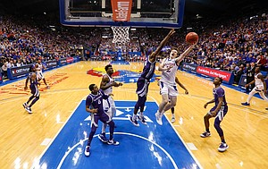 Kansas guard Christian Braun (2) goes to the bucket against Kansas State forward Makol Mawien (14) during the second half, Tuesday, Jan. 21, 2020 at Allen Fieldhouse.