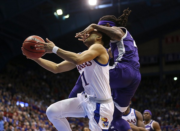 Kansas guard Devon Dotson (1) is fouled by Kansas State guard Cartier Diarra (2) during the second half, Tuesday, Jan. 21, 2020 at Allen Fieldhouse.