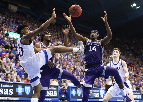Kansas guard Ochai Agbaji (30) battles for a rebound with Kansas State forward Makol Mawien (14) and Kansas State forward Xavier Sneed (20) during the second half, Tuesday, Jan. 21, 2020 at Allen Fieldhouse.