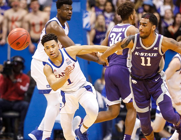 Kansas guard Devon Dotson (1) knocks the ball loose from Kansas State forward Antonio Gordon (11) during the first half, Tuesday, Jan. 21, 2020 at Allen Fieldhouse.