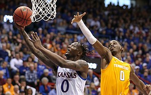 Kansas guard Marcus Garrett (0) floats in for a bucket past Tennessee guard Davonte Gaines (0) during the first half, Saturday, Jan. 25, 2019 at Allen Fieldhouse.