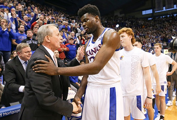 Tennessee head coach Rick Barnes congratulates Kansas center Udoka Azubuike (35) following the Jayhawks' 74-68 win, Saturday, Jan. 25, 2019 at Allen Fieldhouse.