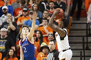 Oklahoma State guard Chris Harris Jr., right, takes a shot over Kansas guard Christian Braun (2) during the second half of an NCAA college basketball game in Stillwater, Okla., Monday, Jan. 27, 2020. Kansas defeated Oklahoma State 65-50. (AP Photo/Brody Schmidt)