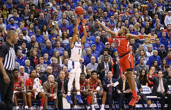 Kansas guard Devon Dotson (1) puts up a three from the corner against Texas Tech guard Jahmi'us Ramsey (3) during the first half, Saturday, Feb. 1, 2020 at Allen Fieldhouse.