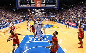 Kansas guard Devon Dotson (1) gets inside for a bucket after weaving through the Texas Tech defense during the second half, Saturday, Feb. 1, 2020 at Allen Fieldhouse.