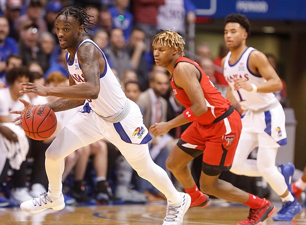 Kansas guard Marcus Garrett (0) comes away with a steal during the first half, Saturday, Feb. 1, 2020 at Allen Fieldhouse.