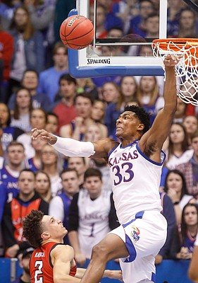 Kansas forward David McCormack (33) rejects a shot from Texas Tech guard Clarence Nadolny (2) during the first half, Saturday, Feb. 1, 2020 at Allen Fieldhouse.