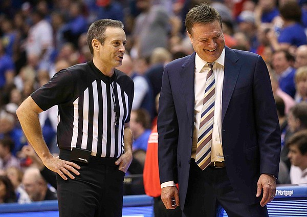 Kansas head coach Bill Self laughs with an official during the second half on Monday, Feb. 3, 2020 at Allen Fieldhouse.