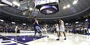 Kansas guard Devon Dotson (1) gets inside TCU guard Edric Dennis (2) to score a basket during the second half of an NCAA college basketball game, Saturday, Feb. 8, 2020 in Fort Worth, Texas. Kansas won 60-46. (AP Photo/Ron Jenkins)