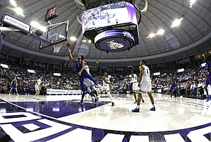 Kansas guard Devon Dotson (1) gets inside TCU guard Edric Dennis (2) to score a basket during the second half of an NCAA college basketball game, Saturday, Feb. 8, 2020 in Fort Worth, Texas. Kansas won 60-46. (AP Photo/Ron Jenkins)