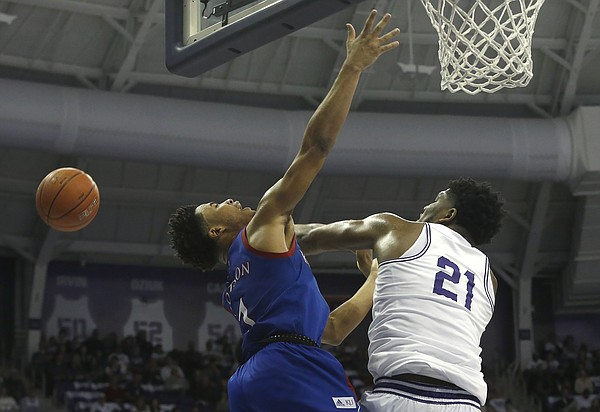 TCU center Kevin Samuel (21) blocks the shot of KU guard Devon Dotson (1) during the second half of an NCAA college basketball game, Saturday, Feb. 8, 2020 in Fort Worth, Texas. Kansas won 60-46. (AP Photo/Ron Jenkins)